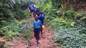 The Water Project:  Walking Down To Collect Water