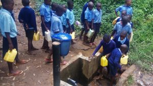 The Water Project:  Collecting Water At Spring