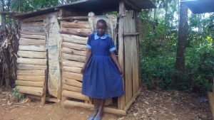 The Water Project:  Girl In Front Of Latrine