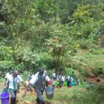 The Water Project: Precious School Kapsambo Secondary -  Students Carry Water Back Up Hill