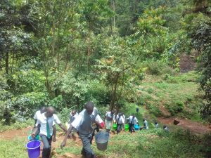 The Water Project:  Students Carry Water Back Up Hill