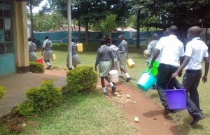 The Water Project:  Students Carry Water Buckets