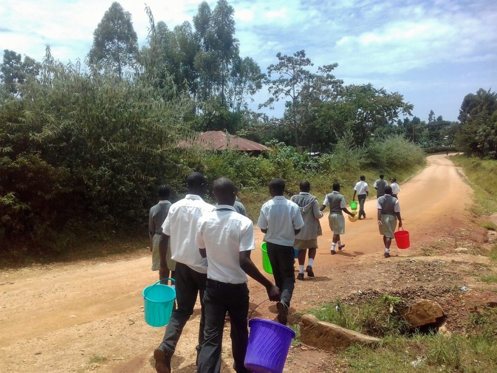 The Water Project : kenya18075-students-carry-water-buckets-down-the-road