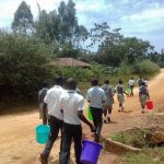 The Water Project: Precious School Kapsambo Secondary -  Students Carry Water Buckets Down The Road