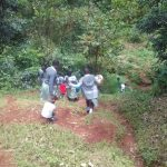 The Water Project: Precious School Kapsambo Secondary -  Students Walk Down Hill To Protected Spring