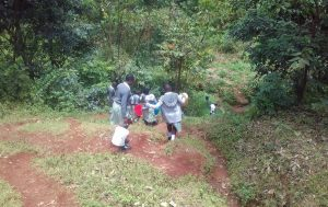 The Water Project:  Students Walk Down Hill To Protected Spring