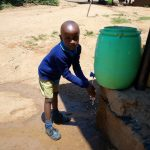 The Water Project: Emukangu Primary School, Shibuli -  Boy Washes His Hands
