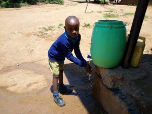The Water Project:  Boy Washes His Hands