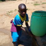 The Water Project: Emukangu Primary School, Shibuli -  Girl Washes Her Hands