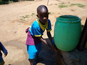The Water Project:  Girl Washes Her Hands