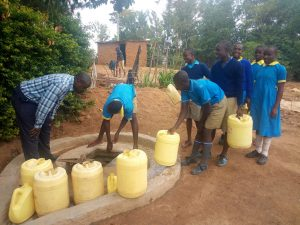 The Water Project:  Students At Well