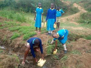 The Water Project:  Students Fetching Water At A Seasonal Passing Stream
