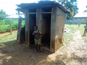 The Water Project:  A Boy Poses At The Boys Latrine Section
