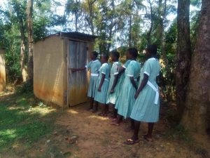 The Water Project:  Girls Line Up To Use Latrine