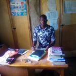 The Water Project: Eshisenye Primary School -  Senior Teacher In His Office
