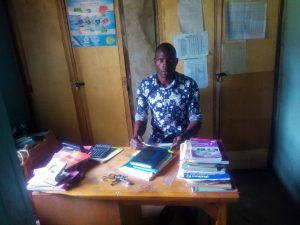The Water Project:  Senior Teacher In His Office
