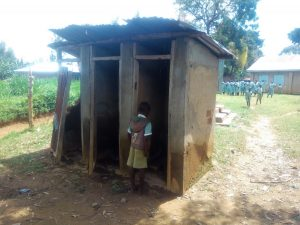 The Water Project:  Student Looks Inside Broken Latrine
