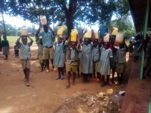 The Water Project:  Students Hold Jerrycans And Water Containers Atop Their Heads