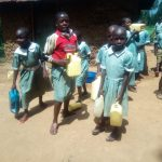 The Water Project: Eshisenye Primary School -  Students Picking Containers Ready To Go Fetch Water