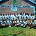 The Water Project: Eshisenye Primary School -  Students Pose In Front Of The School