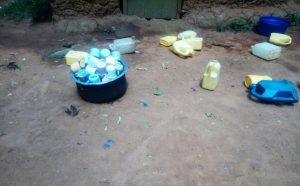 The Water Project:  Water Containers And Cups Lying On The Floor