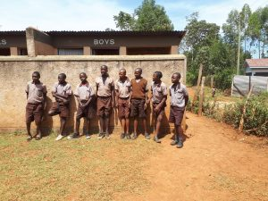 The Water Project:  Boys Stand In Front Of Latrines