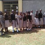 The Water Project: Shitaho Community School -  Girls Line Up For Latrine