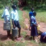 The Water Project: Matsigulu Primary School -  Students Fetching Water To Take To School