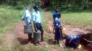 The Water Project:  Students Fetching Water To Take To School