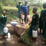 The Water Project: Imbale Primary School -  Drawing Water At The Spring