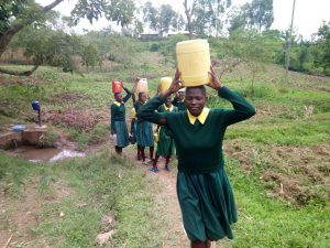 The Water Project:  Girls Carry Water On Their Heads