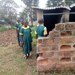 The Water Project: Imbale Primary School -  Girls Line Up To Use Latrines