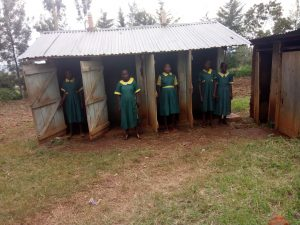 The Water Project:  Girls Pose Infront Of Latrines