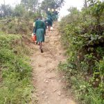 The Water Project: Imbale Primary School -  Steep Climb With Pounds Of Water