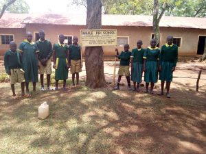The Water Project:  Students Post With Sign