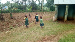 The Water Project:  Young Girls In Front Of Latrines