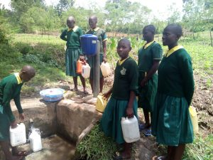 The Water Project:  Girls Collect Water At Spring