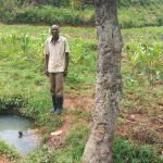 The Water Project: Matsakha Community, Siseche Spring -  Man Stands Next To Spring