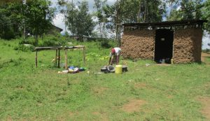 The Water Project:  Cleaning Dishes Outside