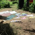 The Water Project: Luvambo Community, Timona Spring -  Clothes Drying On The Ground