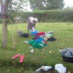 The Water Project: Musutsu Community -  A Lady Washing Her Households Cloths