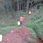 The Water Project: Musutsu Community -  Boy Carries Heavy Jerrycan Full Of Water Up Hill