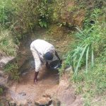 The Water Project: Emachembe Community -  Clearing Spring To Determine Actual Source Of Water
