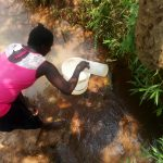 The Water Project: Mungaha B Community, Maria Spring -  Drawing Water At The Spring