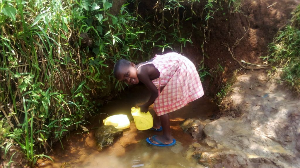 The Water Project : kenya18140-young-becky-fetching-water-at-the-spring