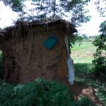 The Water Project: Chegulo Community, Yeni Spring -  A Latrine With A Container For Handwashing