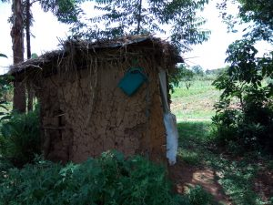 The Water Project:  A Latrine With A Container For Handwashing