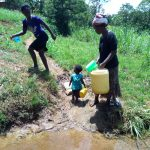The Water Project: Chegulo Community, Yeni Spring -  Community Members At The Spring