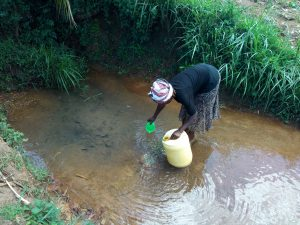 The Water Project:  Filling Smaller Cup To Top Off Jerrycan