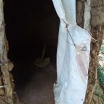 The Water Project: Chegulo Community, Yeni Spring -  Latrine Interior